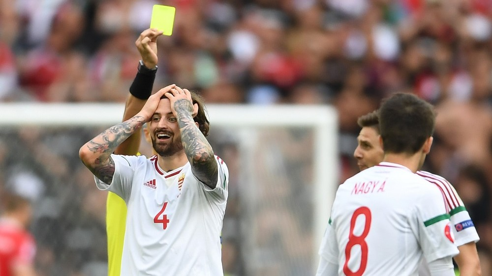 MARSEILLE, FRANCE - JUNE 18:  Tamas Kadar of Hungary recieves a yellow card from referee Sergei Karasev during the UEFA EURO 2016 Group F match between Iceland and Hungary at Stade Velodrome on June 18, 2016 in Marseille, France.  (Photo by Laurence Griffiths/Getty Images)
