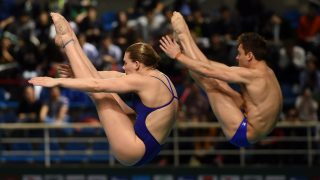 (170310) -- GUANGZHOU, March 10, 2017 (Xinhua) -- Britain's Grace Reid(L)/Thomas Daley compete during the Mixed 3m Synchronised Springboard event at the 2017 FINA Diving World Series in Guangzhou, capital of south China's Guangdong Province, March 10, 2017. They took the fifth place of the event with 309.99 points. (Xinhua/Jia Yuchen)