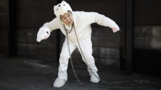 In this picture taken on January 16, 2018, Kimiko Nishimoto, dressed in a dog costume, gestures during a self photoshoot outside her house in the western Japanese city of Kumamoto.The madcap Japanese great-grandmother armed with a camera and an appetite for mischief has shot to fame for taking side-splitting selfies -- many of which appear to put her in harm's way. / AFP PHOTO / Behrouz MEHRI / TO GO WITH Japan-lifestyle-photography-offbeat-senior-citizens,FEATURE by Alistair HIMMER