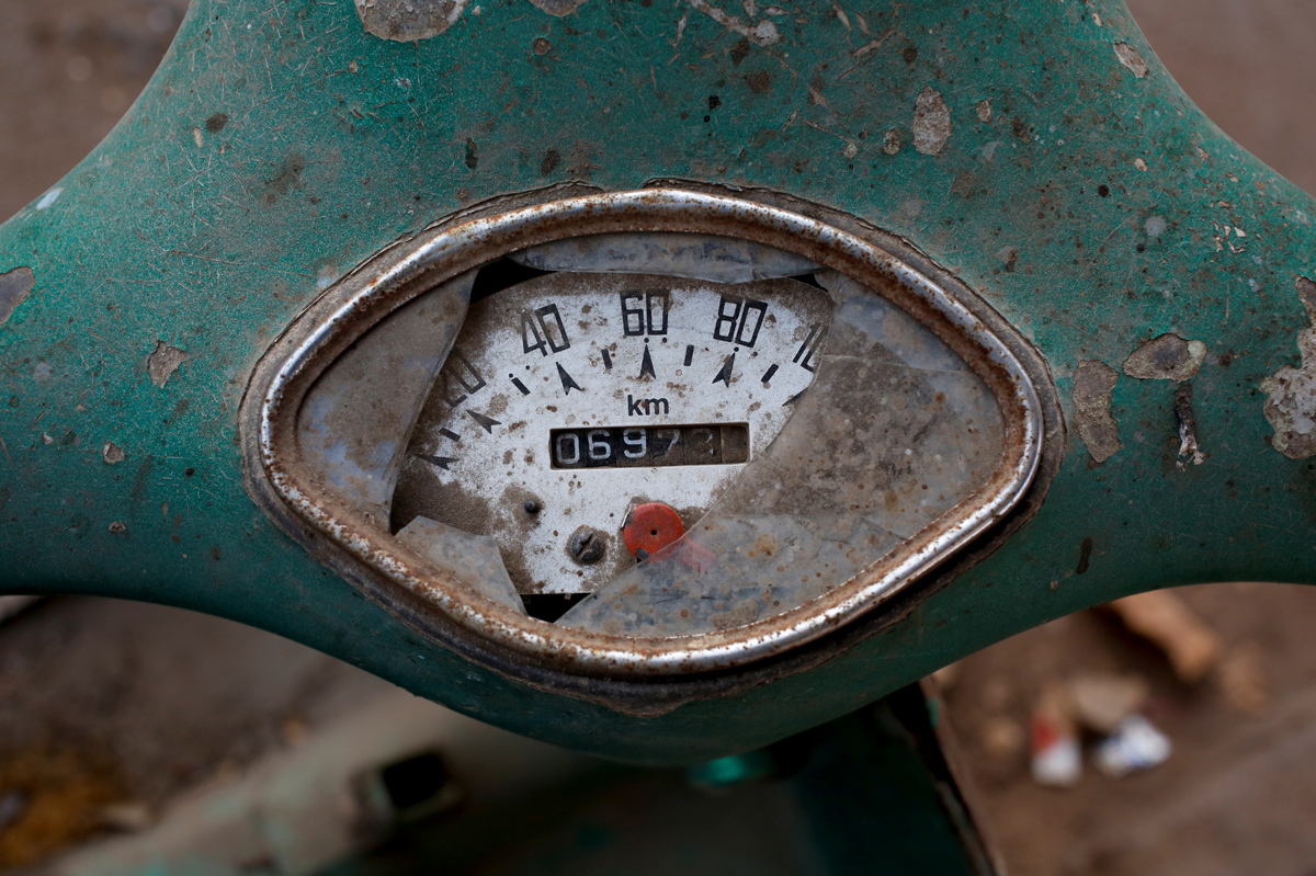 """A broken speed meter is seen on an abandoned Vespa scooter, in a street corner in Karachi, Pakistan, March 6, 2018. REUTERS/Akhtar Soomro  SEARCH """"VESPA PAKISTAN"""" FOR THIS STORY. SEARCH """"WIDER IMAGE"""" FOR ALL STORIES."""