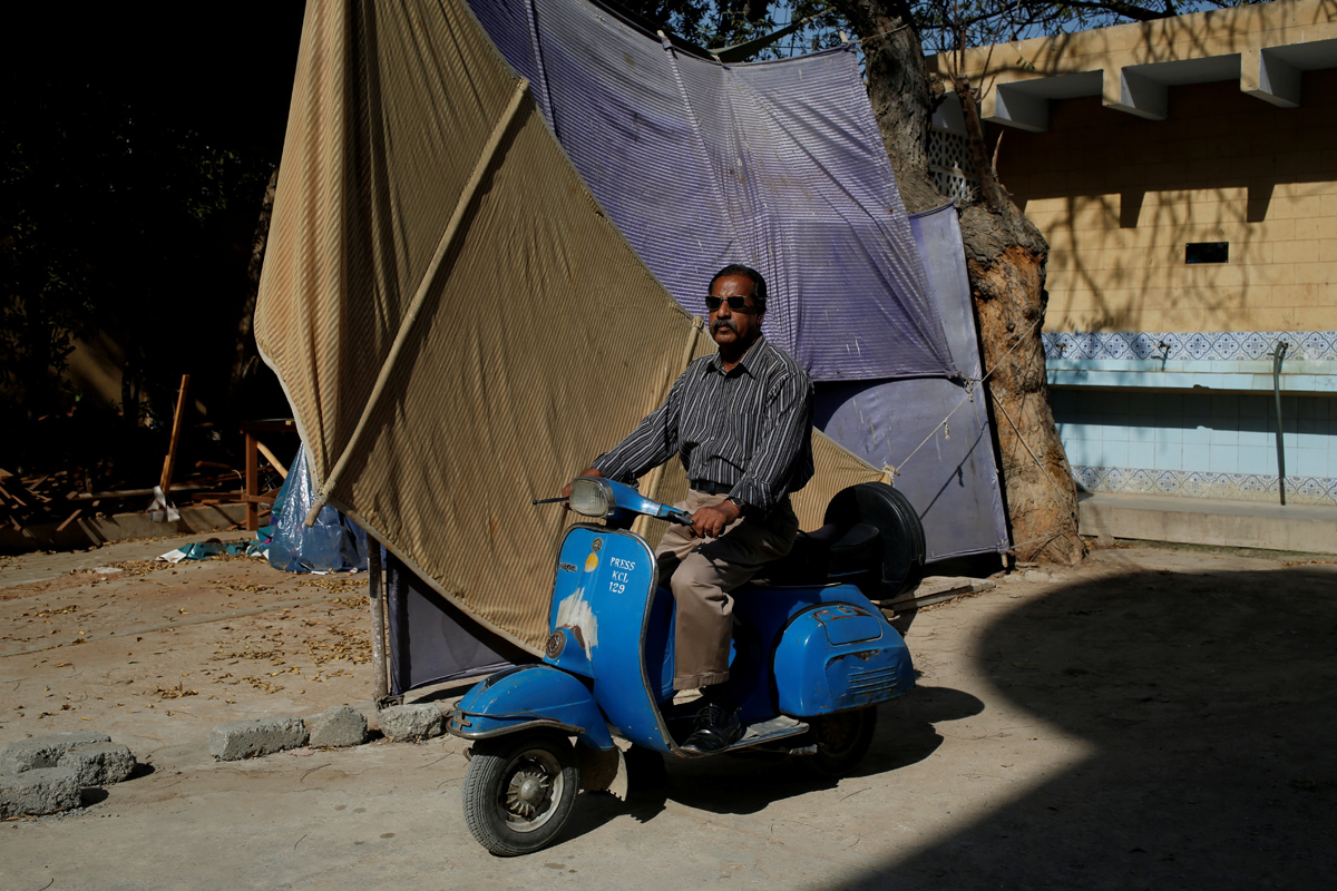 """Journalist Nazeer Udding Siddiqui, 58, poses for a photograph with his 1979 model Vespa scooter in Karachi, Pakistan March 6, 2018. """"My father used to work for Khwaja Auto as a manager and they were the only distributers of Vespa scooters. For me, people who own Vespas are very honourable people who still keep this tradition alive,"""" Siddiqui said. REUTERS/Akhtar Soomro   SEARCH """"VESPA PAKISTAN"""" FOR THIS STORY. SEARCH """"WIDER IMAGE"""" FOR ALL STORIES. TPX IMAGES OF THE DAY"""