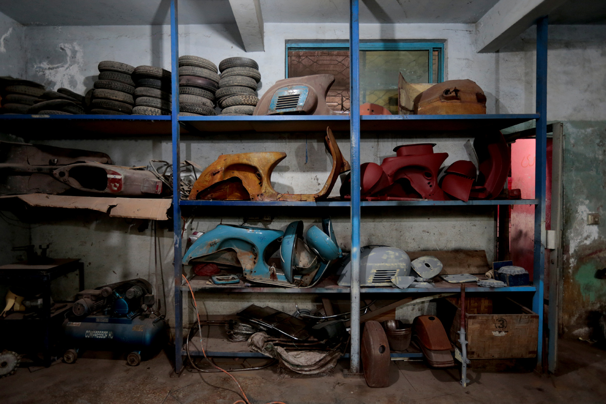 """Disassembled Vespa scooters rest on shelves in different states of restoration, at a Vespa restoration and repair workshop in Islamabad, Pakistan March 6, 2018. REUTERS/Caren Firouz   SEARCH """"VESPA PAKISTAN"""" FOR THIS STORY. SEARCH """"WIDER IMAGE"""" FOR ALL STORIES."""