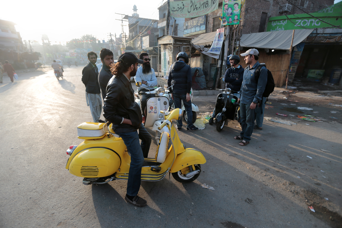 """Members of a Vespa rider's club gather at sunrise for a ride in Lahore, Pakistan March 11, 2018. REUTERS/Caren Firouz   SEARCH """"VESPA PAKISTAN"""" FOR THIS STORY. SEARCH """"WIDER IMAGE"""" FOR ALL STORIES."""