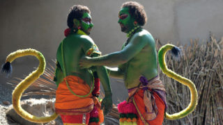 """Indian artists dress up as the Hindu deity """"Hanuman"""" -- the monkey God in Hindu mythology -- to mark the Rama Navami festival in Bangalore on March 25, 2018.Rama Navami is a spring Hindu festival that celebrates the birthday of the deity Rama. He is particularly important to the Vaishnavism tradition of Hinduism, as the seventh avatar of Vishnu. / AFP PHOTO / MANJUNATH KIRAN"""