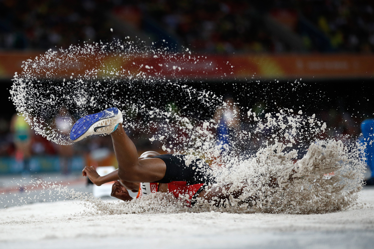 Papua New Guinea's Rellie Kaputin competes in the athletics women's long jump qualifications during the 2018 Gold Coast Commonwealth Games at the Carrara Stadium on the Gold Coast on April 11, 2018. / AFP PHOTO / Adrian DENNIS