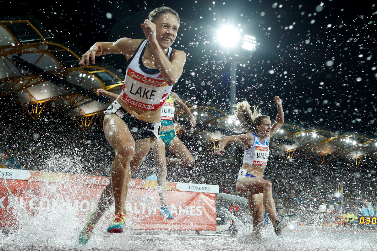 Athletes compete in the athletics women's 3000m steeplechase final during the 2018 Gold Coast Commonwealth Games at the Carrara Stadium on the Gold Coast on April 11, 2018. / AFP PHOTO / Adrian DENNIS