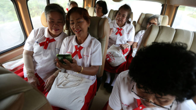 """Students from the School for the Elderly in Chiang Rak Noi subdistrict, travel on the school bus in Ayutthaya, Thailand, March 14, 2018. REUTERS/Athit Perawongmetha  SEARCH """"PERAWONGMETHA SCHOOL"""" FOR THIS STORY. SEARCH """"WIDER IMAGE"""" FOR ALL STORIES."""