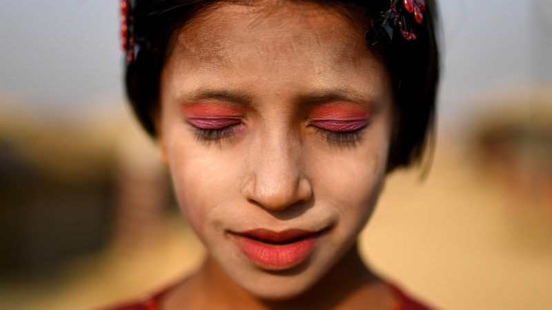 """A Rohingya refugee girl named Amina poses for a photograph as she wears thanaka paste at Kutupalong camp in Cox's Bazaar, Bangladesh, March 30, 2018. REUTERS/Clodagh Kilcoyne. SEARCH """"THANAKA KILCOYNE"""" FOR THIS STORY. SEARCH """"WIDER IMAGE"""" FOR ALL STORIES.    TPX IMAGES OF THE DAY"""
