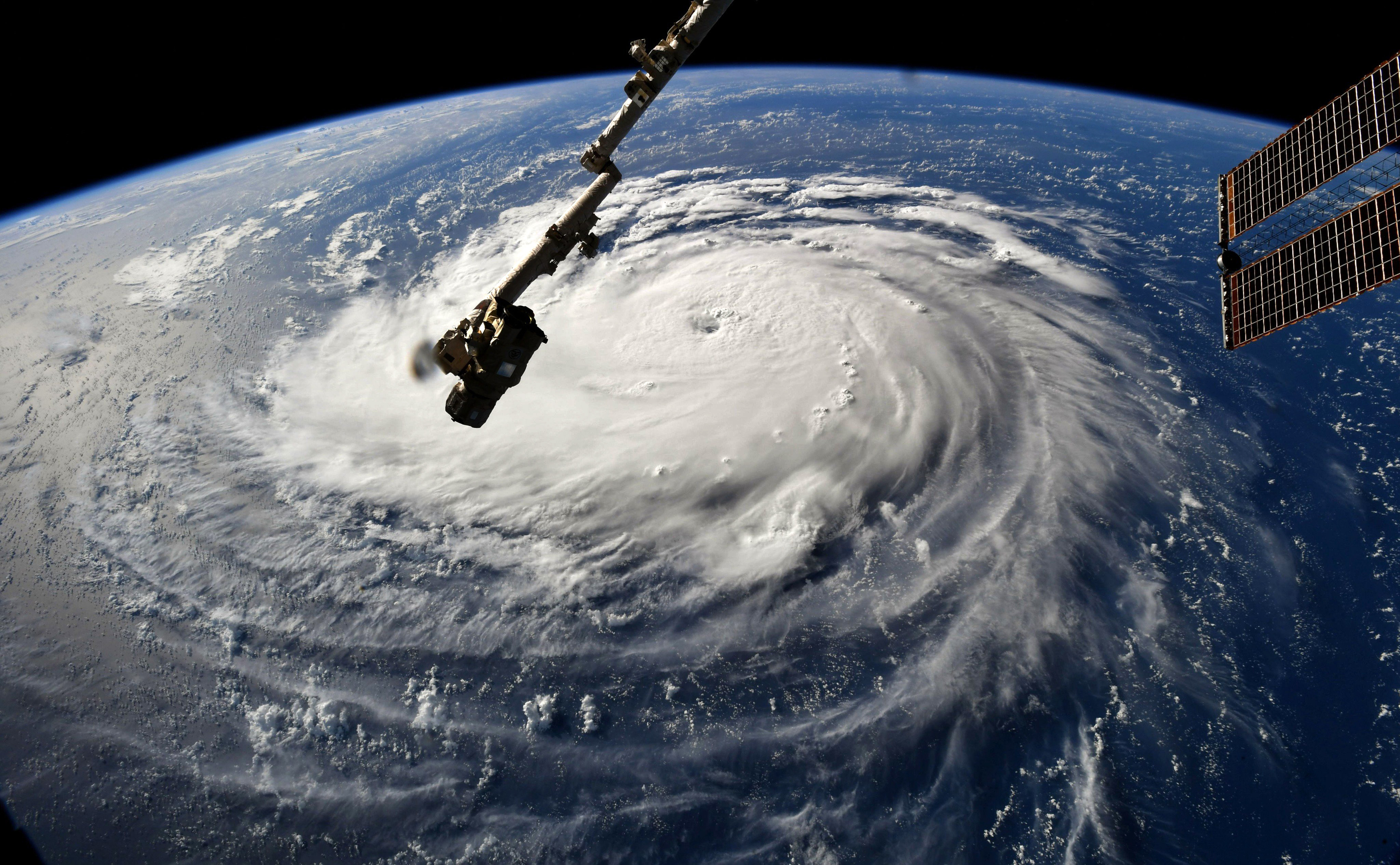 """This NASA handout photo shows a view from the International Space Station of Hurricane Florence off the US east coast in the Atantic Ocean on September 10, 2018.Hurricane Florence threatening the southeastern coast of the United States strengthened Monday morning into a Category 3 """"major"""" hurricane, the National Hurricane Center said.The NHC said the Atlantic hurricane's maximum sustained winds have increased to nearly 115 miles per hour (185 kilometers per hour) with higher gusts.""""Florence is expected to be an extremely dangerous major hurricane through Thursday,"""" it said. / AFP PHOTO / NASA / Handout AND Ricky ARNOLD / RESTRICTED TO EDITORIAL USE - MANDATORY CREDIT """"AFP PHOTO / NASA / RICKY ARNOLD"""" - NO MARKETING NO ADVERTISING CAMPAIGNS - DISTRIBUTED AS A SERVICE TO CLIENTS"""