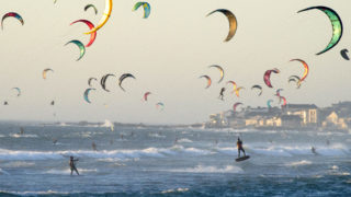 Kitesurfers kitesurf in good wind and weather on February 6, 2019, in Tableview, about 15km from the centre of Cape Town. (Photo by RODGER BOSCH / AFP)