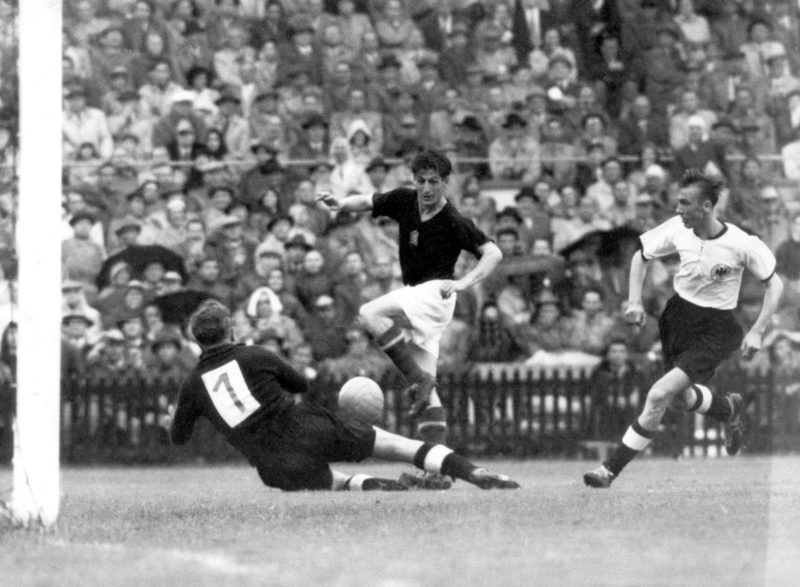 Dangerous action in front of Germany's goal: goalkeeper Toni Turek (l) runs towards Hungarian striker Sandor Kocsis (c), to the right runner Horst Eckel. The German national football team beats Hungary 3:2 in the 1954 FIFA World Cup final at Bern's Wankdorf stadium in front of 60.000 spectators on the 4th of Julyin 1954 and wins the title for the first time.