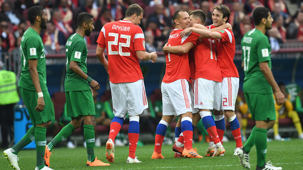 Russia's players celebrate after scoring their fifth goal during the Russia 2018 World Cup Group A football match between Russia and Saudi Arabia at the Luzhniki Stadium in Moscow on June 14, 2018. / AFP PHOTO / Francisco LEONG / RESTRICTED TO EDITORIAL USE - NO MOBILE PUSH ALERTS/DOWNLOADS