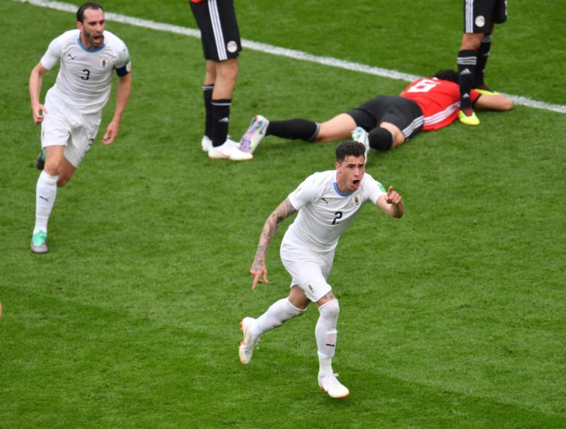 Uruguay's defender Jose Gimenez (R) celebrates scoring the opening goal during the Russia 2018 World Cup Group A football match between Egypt and Uruguay at the Ekaterinburg Arena in Ekaterinburg on June 15, 2018. / AFP PHOTO / HECTOR RETAMAL / RESTRICTED TO EDITORIAL USE - NO MOBILE PUSH ALERTS/DOWNLOADS