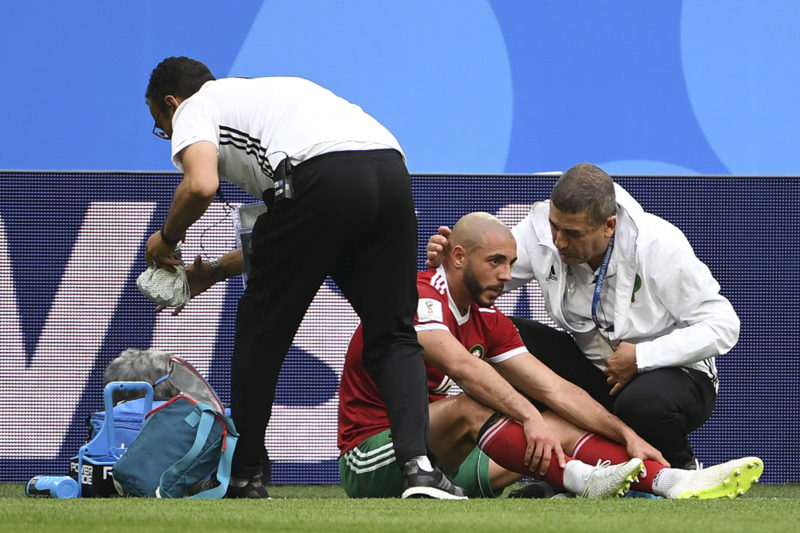 Morocco's forward Noureddine Amrabat receives medical attention on the sidelines during the Russia 2018 World Cup Group B football match between Morocco and Iran at the Saint Petersburg Stadium in Saint Petersburg on June 15, 2018. / AFP PHOTO / Paul ELLIS / RESTRICTED TO EDITORIAL USE - NO MOBILE PUSH ALERTS/DOWNLOADS