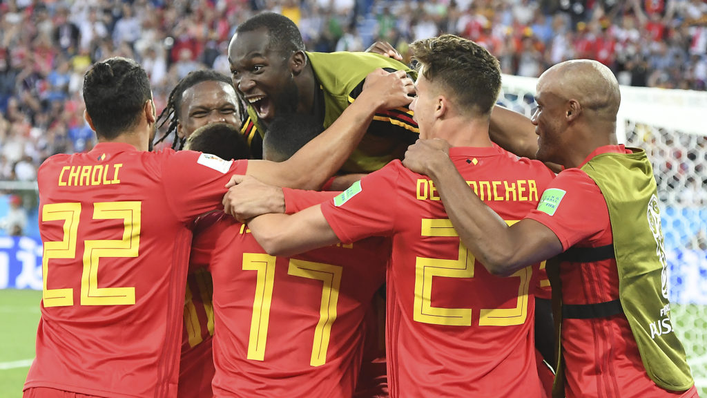 Belgium's forward Adnan Januzaj (hidden) celebrates scoring the opening goal with his teammates during the Russia 2018 World Cup Group G football match between England and Belgium at the Kaliningrad Stadium in Kaliningrad on June 28, 2018. / AFP PHOTO / Attila KISBENEDEK / RESTRICTED TO EDITORIAL USE - NO MOBILE PUSH ALERTS/DOWNLOADS