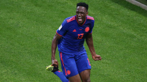Colombia's defender Yerry Mina celebrates after scoring the opener during the Russia 2018 World Cup Group H football match between Poland and Colombia at the Kazan Arena in Kazan on June 24, 2018. / AFP PHOTO / Roman Kruchinin / RESTRICTED TO EDITORIAL USE - NO MOBILE PUSH ALERTS/DOWNLOADS