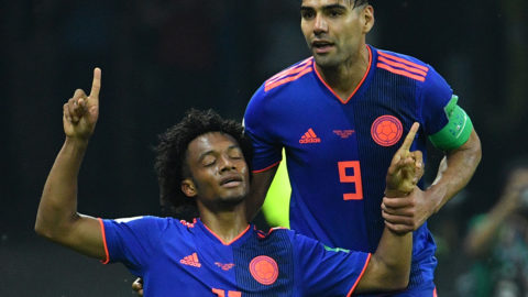 Colombia's forward Juan Cuadrado (L) celebrates with Colombia's forward Falcao after scoring their third goal during the Russia 2018 World Cup Group H football match between Poland and Colombia at the Kazan Arena in Kazan on June 24, 2018. / AFP PHOTO / SAEED KHAN / RESTRICTED TO EDITORIAL USE - NO MOBILE PUSH ALERTS/DOWNLOADS