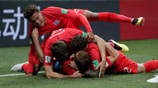 Soccer Football - World Cup - Group G - Tunisia vs England - Volgograd Arena, Volgograd, Russia - June 18, 2018   England's Harry Kane celebrates with John Stones, Kieran Trippier and Dele Alli after scoring their first goal    REUTERS/Ueslei Marcelino