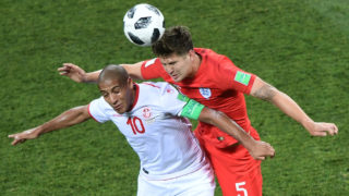 Tunisia's forward Wahbi Khazri (L) vies for the ball with England's defender John Stones during the Russia 2018 World Cup Group G football match between Tunisia and England at the Volgograd Arena in Volgograd on June 18, 2018. / AFP PHOTO / NICOLAS ASFOURI / RESTRICTED TO EDITORIAL USE - NO MOBILE PUSH ALERTS/DOWNLOADS