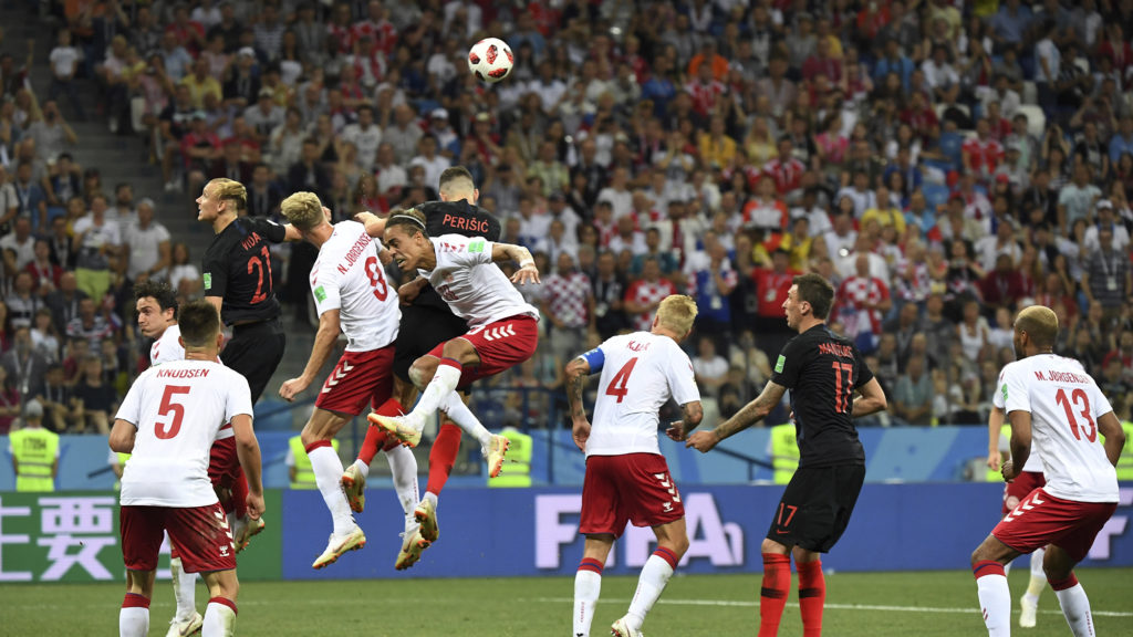 (jumping L-R) Croatia's defender Domagoj Vida, Denmark's forward Nicolai Jorgensen, Denmark's forward Yussuf Poulsen and Croatia's forward Ivan Perisic vie for the ball during the Russia 2018 World Cup round of 16 football match between Croatia and Denmark at the Nizhny Novgorod Stadium in Nizhny Novgorod on July 1, 2018. / AFP PHOTO / Dimitar DILKOFF / RESTRICTED TO EDITORIAL USE - NO MOBILE PUSH ALERTS/DOWNLOADS