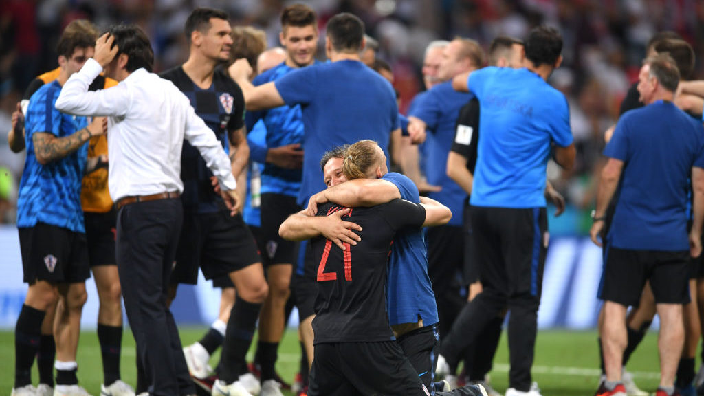 SOCHI, RUSSIA - JULY 07:  Domagoj Vida of Croatia hugs a member of the backroom staff after the 2018 FIFA World Cup Russia Quarter Final match between Russia and Croatia at Fisht Stadium on July 7, 2018 in Sochi, Russia.  (Photo by Laurence Griffiths/Getty Images)