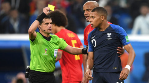 SAINT PETERSBURG, RUSSIA - JULY 10:  Kylian Mbappe of France is shown a yellow card by referee Andres Cunha during the 2018 FIFA World Cup Russia Semi Final match between Belgium and France at Saint Petersburg Stadium on July 10, 2018 in Saint Petersburg, Russia.  (Photo by Shaun Botterill/Getty Images)