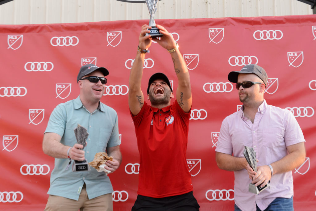 JOLIET, IL - AUGUST 01:  Nemanja Nikolic of Chicago Fire (C) poses with other winners in the winner's circle as Audi hits the track with Major League Soccer All-Star players ahead of MLS All-Star Game in Chicago at Autobahn Country Club on August 1, 2017 in Joliet, Illinois.  (Photo by Daniel Boczarski/Getty Images for Audi)