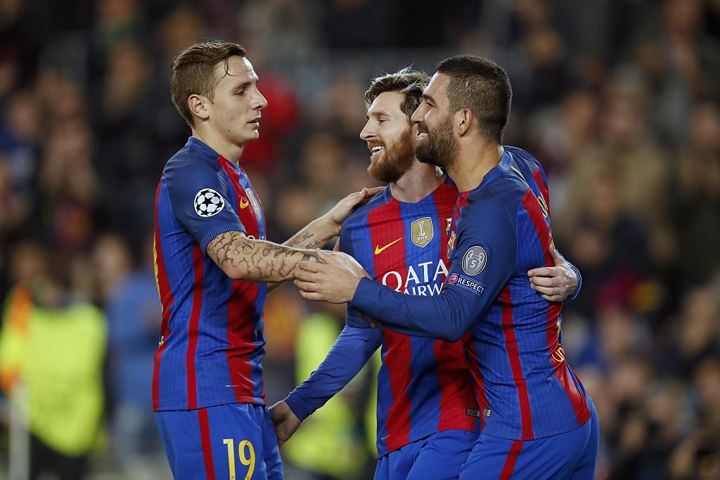 (L-R) Lucas Digne of FC Barcelona, Lionel Messi of FC Barcelona, Arda Turan of FC Barcelonaduring the UEFA Champions League group C match between FC Barcelona and Borussia Monchengladbach on December 06, 2016 at the Camp Nou stadium in Barcelona, Spain.(Photo by VI Images via Getty Images)