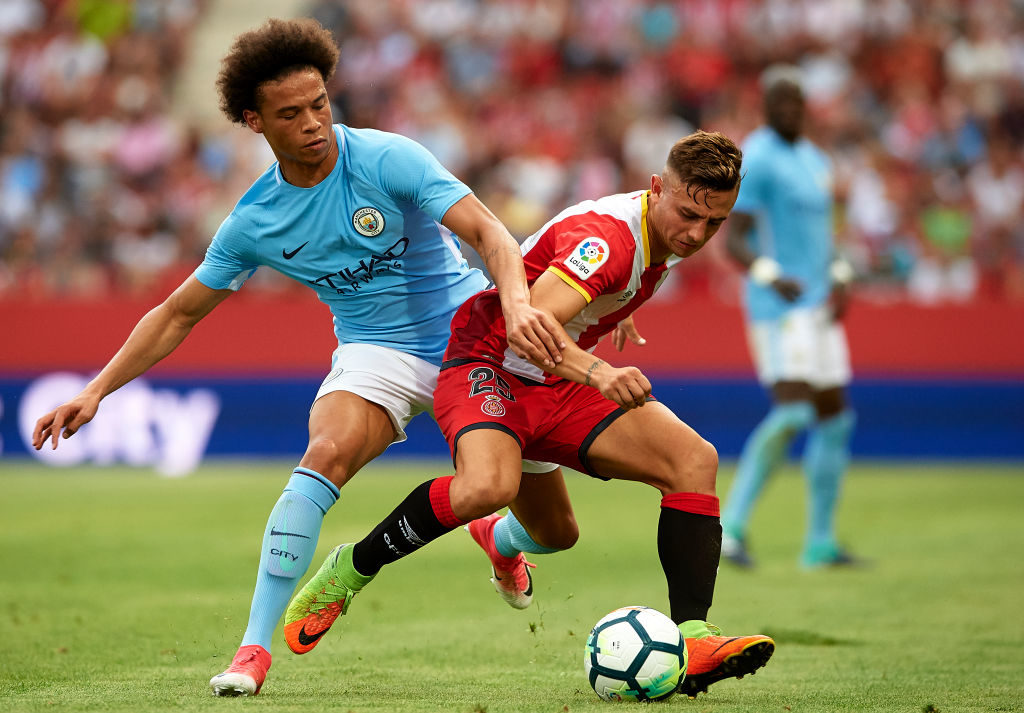 GIRONA, SPAIN - AUGUST 15:  Maffeo (R) of Girona is challenged by Leroy Sane of Manchester City during the pre-season friendly match between Girona and Manchester City at Municipal de Montilivi Stadium on August 15, 2017 in Girona, Spain.  (Photo by Manuel Queimadelos Alonso/Getty Images)