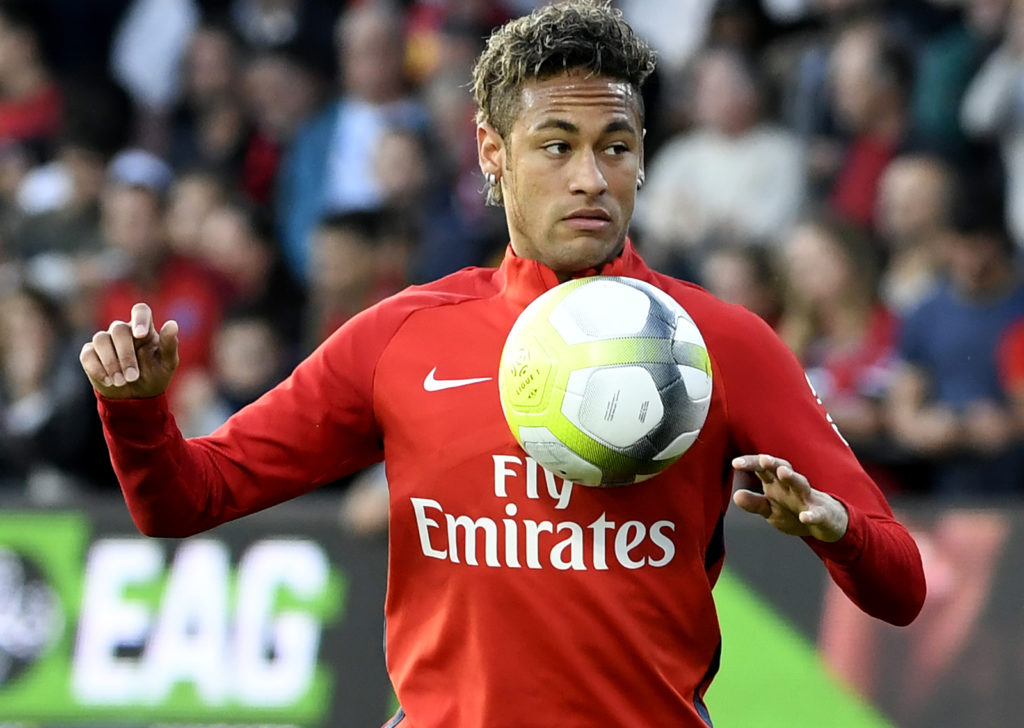 Paris Saint-Germain's Brazilian forward Neymar warms up prior to the French L1 football match Paris Saint-Germain (PSG) vs En Avant Guingamp (EAG) at the Roudourou stadium in Guingamp on August 13, 2017. / AFP PHOTO / FRED TANNEAU