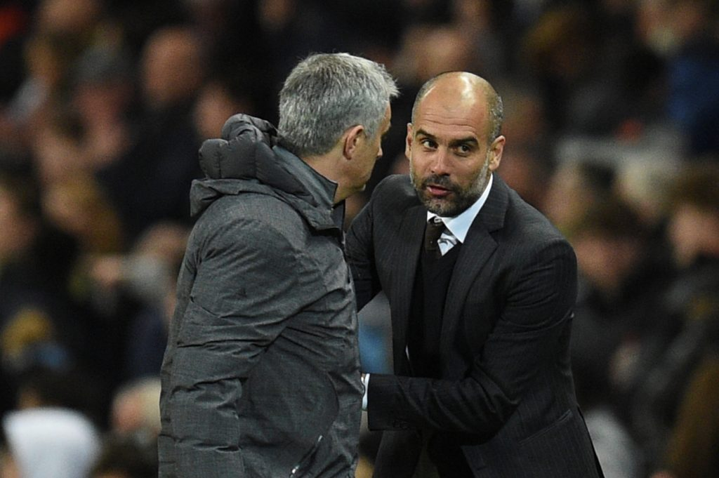 Manchester United's Portuguese manager Jose Mourinho (L) embraces Manchester City's Spanish manager Pep Guardiola (R) on the touchline at the end of the English Premier League football match between Manchester City and Manchester United at the Etihad Stadium in Manchester, north west England, on April 27, 2017. / AFP PHOTO / Oli SCARFF / RESTRICTED TO EDITORIAL USE. No use with unauthorized audio, video, data, fixture lists, club/league logos or 'live' services. Online in-match use limited to 75 images, no video emulation. No use in betting, games or single club/league/player publications.  /