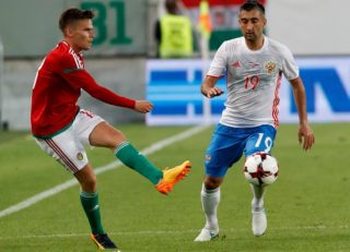 BUDAPEST, HUNGARY - JUNE 5: Zoltan Stieber (L) of Hungary passes the ball beside Aleksandr Samedov #19 of Russia during the International Friendly match between Hungary and Russia at Groupama Arena on June 5, 2017 in Budapest, Hungary. (Photo by Laszlo Szirtesi/Getty Images)