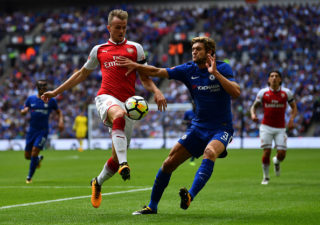 LONDON, ENGLAND - AUGUST 06: Rob Holding of Arsenal and Marcos Alonso of Chelsea battle for possession during the The FA Community Shield final between Chelsea and Arsenal at Wembley Stadium on August 6, 2017 in London, England.  (Photo by Dan Mullan/Getty Images)