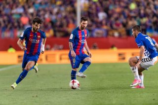 MADRID, SPAIN - MAY 27: Lionel Andres Messi of FC Barcelona (C) looks to bring the ball down for Andre Filipe Tavares Gomes of FC Barcelona (L) during the Copa Del Rey Final between FC Barcelona and Deportivo Alaves at Vicente Calderon Stadium on May 27, 2017 in Madrid, Spain. (Photo by Power Sport Images/Getty Images)