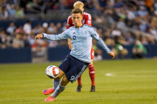 KANSAS CITY, KS - MAY 29:  Krisztian Nemeth #9 of Sporting KC drives the ball forward against the FC Dallas defense late in the first half on May 29, 2015 at Sporting Park in Kansas City, Kansas.  (Photo by Kyle Rivas/Getty Images)