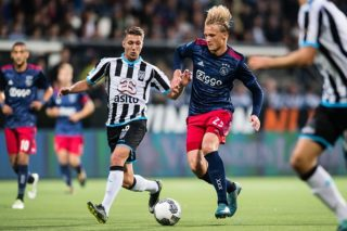 (L-R) Peter van Ooijen of Heracles Almelo, Kasper Dolberg of Ajax during the Dutch Eredivisie match between Heracles Almelo and Ajax Amsterdam at Polman stadium on August 12, 2017 in Almelo, The Netherlands(Photo by VI Images via Getty Images)