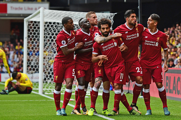 WATFORD, ENGLAND - AUGUST 12: Mohamed Salah of Liverpool celebrates scoring his sides third goal with his Liverpool team mates during the Premier League match between Watford and Liverpool at Vicarage Road on August 12, 2017 in Watford, England.  (Photo by Alex Broadway/Getty Images)