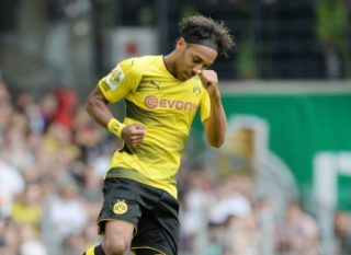 Dortmund's Pierre Aubameyang celebrates after giving his side a 2:0 lead during the German Soccer Association (DFB)Cup first-round soccer match between 1. FC Rielasingen-Arlen and Borussia Dortmund in the Schwarzwald Stadium in Freiburg, Germany, 12 August 2017.  (EMBARGO CONDITIONS - ATTENTION: The DFB prohibits the utilisation and publication of sequential pictures on the internet and other online media during the match (including half-time). ATTENTION: BLOCKING PERIOD! The DFB permits the further utilisation and publication of the pictures for mobile services (especially MMS) and for DVB-H and DMB only after the end of the match.) Photo: Patrick Seeger/dpa
