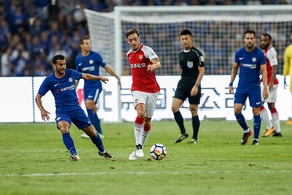BEIJING, CHINA - JULY 22:  Mesut Ozil of Arsenal passes during the Pre-Season Friendly match between Arsenal FC and Chelsea FC at Birds Nest on July 22, 2017 in Beijing, China.  (Photo by Yifan Ding/Getty Images )