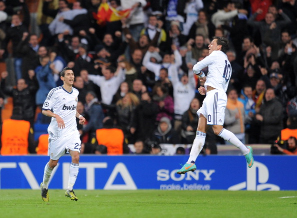 MADRID, SPAIN - NOVEMBER 06:  Mesut Ozil (R) of Real Madrid celebrates with Angel Di Maria after scoring their goal during the UEFA Champions League Group D match between Real Madrid and Borussia Dortmund at Estadio Santiago Bernabeu on November 6, 2012 in Madrid, Spain.  (Photo by Denis Doyle/Getty Images)