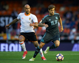 VALENCIA, SPAIN - APRIL 26:  Simone Zaza (L) of Valencia competes for the ball with Inigo Martinez of Real Sociedad  during the La Liga match between Valencia CF and Real Sociedad de Futbol at Mestalla Stadium on April 26, 2017 in Valencia, Spain.  (Photo by fotopress/Getty Images)