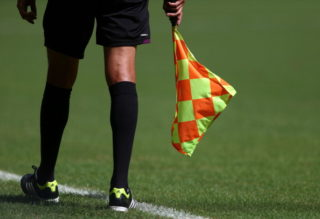 SALVADOR, BRAZIL - JUNE 30:   Detail of the Assistant Referee's flag during the FIFA Confederations Cup Brazil 2013 3rd Place match between Uruguay and Italy at Estadio Octavio Mangabeira (Arena Fonte Nova Salvador) on June 30, 2013 in Salvador, Brazil.  (Photo by Clive Mason/Getty Images)
