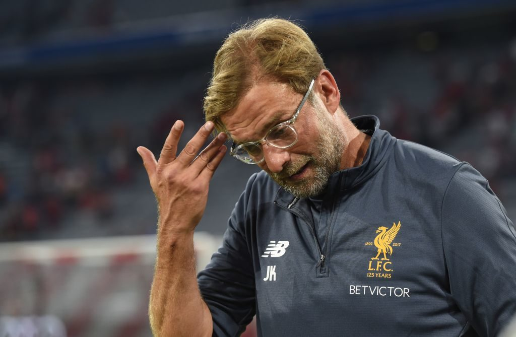 dpatop - Liverpool's Jürgen Klopp wipes the sweat off his brow during the Audi Cup final soccer match between Atletico Madrid and FC Liverpool in the Allianz Arena in Munich, Germany, 2 August 2017. Photo: Andreas Gebert/dpa