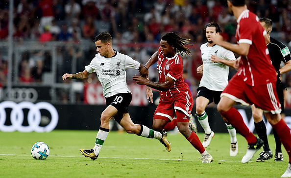 MUNICH, GERMANY - AUGUST 01:  (THE SUN OUT, THE SUN ON SUNDAY OUT) Philippe Coutinho of Liverpool competes with Renato Sanches of Bayern Muenchen during the Audi Cup 2017 match between Bayern Muenchen and Liverpool FC at Allianz Arena on August 1, 2017 in Munich, Germany.  (Photo by Andrew Powell/Liverpool FC via Getty Images)