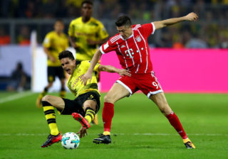 DORTMUND, GERMANY - AUGUST 05:  Marc Bartra (L) of Dortmund and Robert Lewandowski of Muenchen battle for the ball during the DFL Supercup 2017 match between Borussia Dortmund  and Bayern Muenchen at Signal Iduna Park on August 5, 2017 in Dortmund, Germany.  (Photo by Martin Rose/Bongarts/Getty Images)