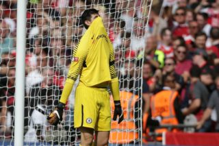 Chelsea's Belgian goalkeeper Thibaut Courtois reacts to conceding a goal during the shoot-out during the English FA Community Shield football match between Arsenal and Chelsea at Wembley Stadium in north London on August 6, 2017. Arsenal won 4-1 on penalties after the game ended 1-1. / AFP PHOTO / Daniel LEAL-OLIVAS / NOT FOR MARKETING OR ADVERTISING USE / RESTRICTED TO EDITORIAL USE