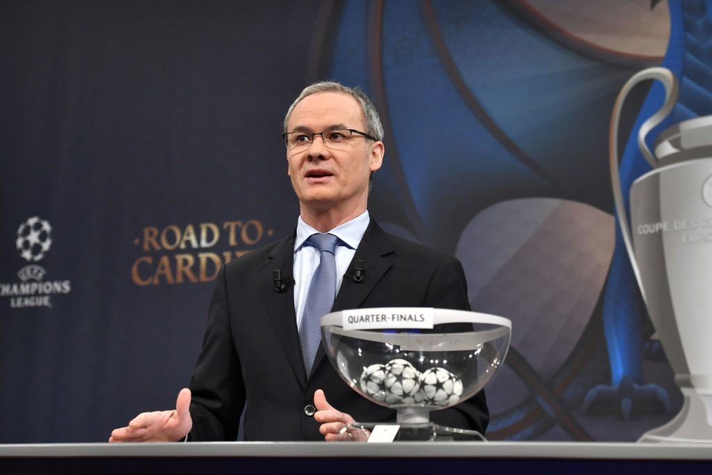 UEFA director of competitions Giorgio Marchetti takes part in the ceremony for the quarter-final draw of the quarter-final draw for the UEFA Champions League football tournament at the UEFA headquarters in Nyon on December 17, 2017. / AFP PHOTO / Fabrice COFFRINI