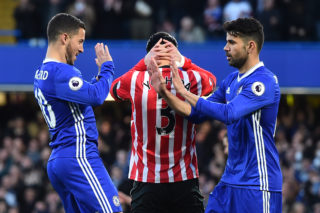 Chelsea's Belgian midfielder Eden Hazard (L) celebrates with Chelsea's Brazilian-born Spanish striker Diego Costa (R) after scoring the opening goal of the English Premier League football match between Chelsea and Southampton at Stamford Bridge in London on April 25, 2017. / AFP PHOTO / Glyn KIRK / RESTRICTED TO EDITORIAL USE. No use with unauthorized audio, video, data, fixture lists, club/league logos or 'live' services. Online in-match use limited to 75 images, no video emulation. No use in betting, games or single club/league/player publications.  /