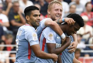 Monaco's Brazilian defender Jemerson (R) is congratuled by teammates Monaco's Colombian forward Radamel Falcao (L) and Monaco's Polish defender Kamil Glik (C) after scoring durin the French L1 football match between Dijon FCO and AS Monaco, on August 13, 2017 at Gaston Gerard stadium in Dijon, northern France. / AFP PHOTO / PHILIPPE DESMAZES