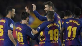 Barcelona's Argentinian forward Lionel Messi (2L) celebrates with teammates Barcelona's Spanish midfielder Sergio Busquets, Barcelona's Spanish defender Jordi Alba, Barcelona's Spanish defender Gerard Pique and Barcelona's French forward Ousmane Dembele after scoring his second goal during the Spanish league football match between FC Barcelona and Girona FC at the Camp Nou stadium in Barcelona on February 24, 2018. / AFP PHOTO / LLUIS GENE